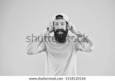 There is music for every man. Bearded man in trendy hipster style smiling on yellow background. Happy man with beard and mustache wearing modern headphones. Brutal man enjoy listening to music. #1558120166