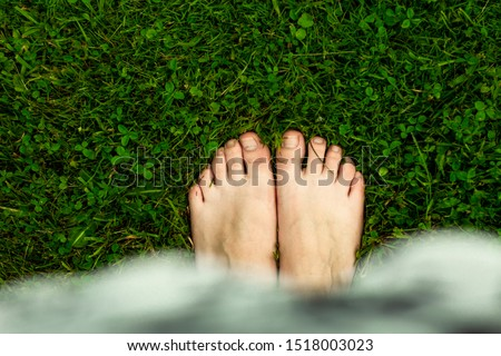 There is nothing better to walk on the wet lawn, after the rain, barefoot. ストックフォト ©