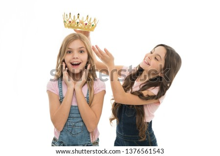 There is only one champion. Adorable small child rewarding cute little champion girl with crown. Happy little winner and champion at pageantry of coronation. A champion is being crowned.