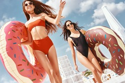 There's no fear when you're having fun. Girls having fun at the rooftop swimming pool