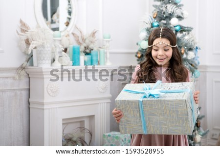 Theres no surprise bigger. Surprised child. Little girl hold surprise box. Happy kid celebratexmas and new year. Receiving Christmas surprise. Happy holidays. Surprise inside gift pack.