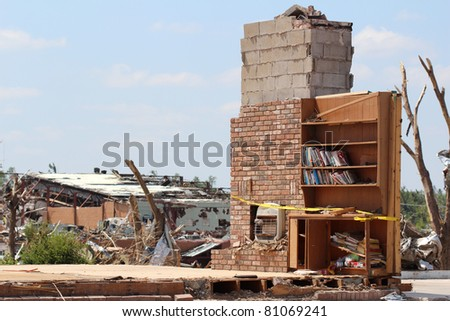 Theres nothing left but part of a chimney and a bookshelf with books intact after an EF-5 tornado destroyed thousands of homes and buisinesses and caused multi million dollars of damage in Joplin, Mo.