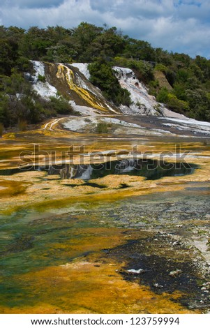 Thermal attraction in New Zealand showing silica overflows and green and yellow algae