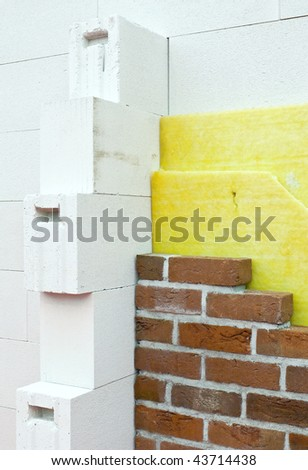 Thermal insulation of a brick wall at a construction site
