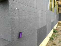 Thermal insulation with graphite polystyrene on the house wall at the construction site