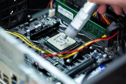 Thermal paste is applied to the laptop processor