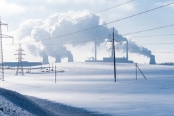 Thermal power plant pipes in winter. Industrial landscape.
