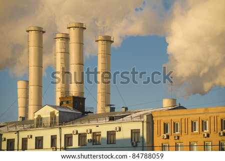 Thermal power station chimneys. An industrial building