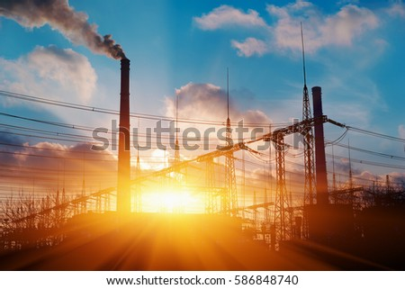Thermal power stations and power lines during sunset #586848740