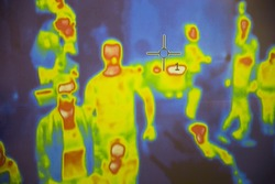 Thermal scanner / camera detecting infected people with Covid-19. Group of people under thermal imaging camera. Modern airport checking system.