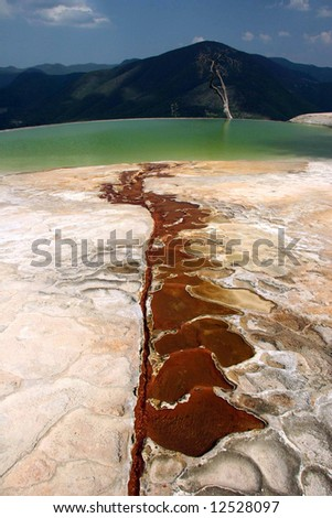 Thermal spring in Salinas. Terraced standing water near famous attraction Hierve el Agua. Oaxaca. Mexico.