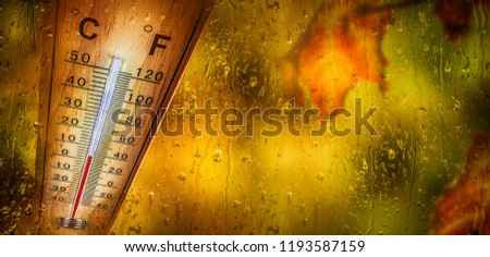 Thermometer behind the window shows a low temperature of celsius and fahrenheit.