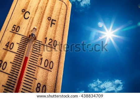 Thermometer displaying high 40 degree hot temperatures in sun summer day. #438834709