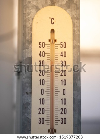 Thermometer hang on metal pole show 31 degree Celsius on a hot summer day. A thermometer is a device that measures temperature or a temperature gradient. #1519377203