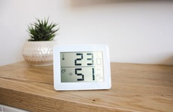 Thermometer hygrometer measuring the optimum temperature and humidity in a house, apartment or office, a photo for articles about the house's microclimate, health, disease relief and virus treatment