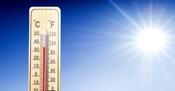 Thermometer in summer day shows or indicate high temperature degree with sun in background.