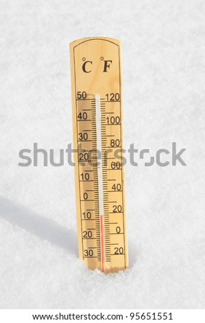 Thermometer in the snow - stock photo