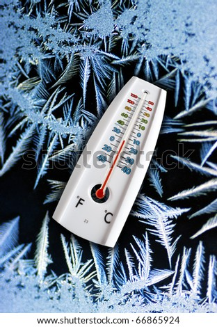 Thermometer indicating freezing temperatures in winter.
