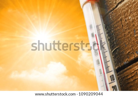Thermometer is hot in the sky, concept of hot weather