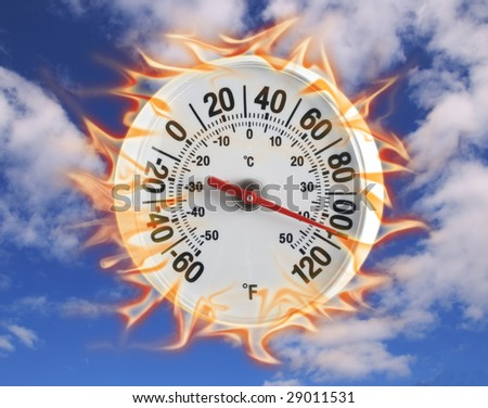 Thermometer on fire with blue sky