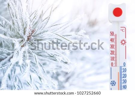 Thermometer registering temperature below zero outdoor #1027252660