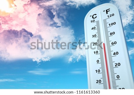 Thermometer show temperature at 20 degree Celsius in bright blue sky
