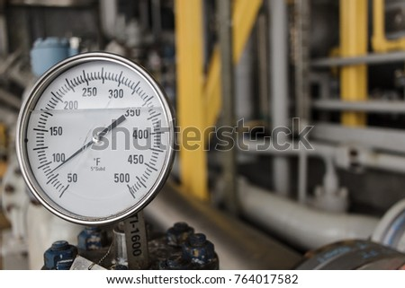 Thermometer, Temperature gauge or temperature indicator reading eighty five Fahrenheit (°F) in offshore oil and gas refinery process operation industry.