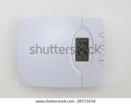 Thermostat isolated on white wall
