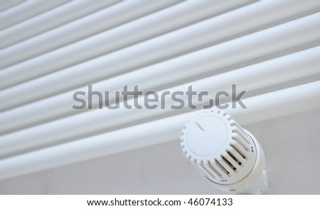 Thermostat with towel - heater - stock photo
