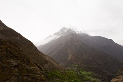 These are the hills and mountains in between roads of skardu and hunza. You can see houses built in between the mountains. The pictures were clicked after rain.