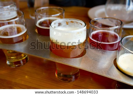 These craft microbrew beers are in a sampler tray at a brewery in Oregon. - stock photo