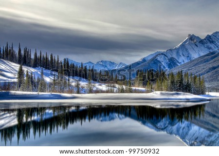 These cross reflections are on the south end of Old Goat Pond in Spray Valley Provincial Park in Alberta, Canada.