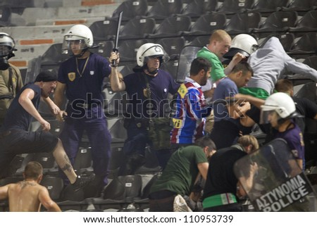 THESSALONIKI, GREECE-AUG 23:Clashes PAOK Thessaloniki and Rapid Vienna fans and the police before UEFA Europe League Playoff Football Match at Toumba Stadium on August 23, 2012 in Thessaloniki,Greece.