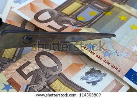 THESSALONIKI, GREECE - AUG 23: Scissors to cut a 50 euro bill on August 23, 2012 in Thessaloniki,Greece.