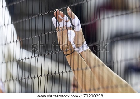 THESSALONIKI GREECE FEBRUARY 15 2014 Hands on net during the Hellenic Volleyball League game Paok vs Olympiacos at PAOK Sports Arena Shallow dof