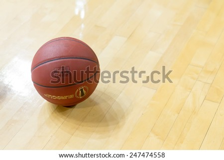 THESSALONIKI, GREECE - JAN 21, 2015: Basketball ball on the ground prior to the Eurocup game Paok vs Khimki in Paok Sports Arena.
