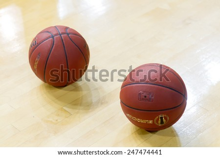 THESSALONIKI, GREECE - JAN 21, 2015: Basketball balls on the ground prior to the Eurocup game Paok vs Khimki in Paok Sports Arena.