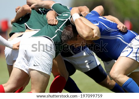 THESSALONIKI, GREECE- MAY 31, 2014: Rugby players pushing in a scrum during the match Greece vs Bulgaria for the European Championship Rugby, which took place in Thessaloniki, Greece.
