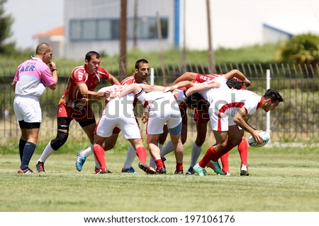 THESSALONIKI, GREECE- MAY 31, 2014: Rugby players pushing in a scrum during the match Turkey vs Montenegro for the European Championship Rugby, which took place in Thessaloniki, Greece.