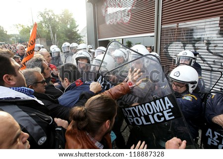 THESSALONIKI,GREECE-NOV,15:Municipal workers clash with riot police during a demonstration against the presence of German Deputy Labor minister Hans-Joachim Fuchtel in Thessaloniki 15 November,2012