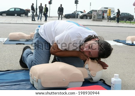 THESSALONIKI, GREECE- OCTUBER 16, 2013: The instructor showing CPR on training doll. Free First Aid, CPR lessons given in the center of Thessaloniki, Greece.