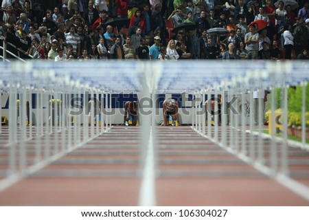THESSALONIKI, GREECE - SEPT 12: Athletes compete the men's 110m hurdles final at the IAAF 2009 World Athletics Final on September 12, 2009 in Kaftatzoglio stadium,Thessaloniki,Greece