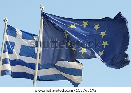 THESSALONIKI,GREECE - SEPT 4: European Union flag and Greek flag, waving in the wind on September 4, 2012 in Thessaloniki, Greece
