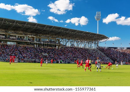 THESSALONIKI, GREECE, -SEPT 22 : Panoramic view of the full Toumba Stadium in the early evening during the Superleague match Paok vs Platanias on September 22, 2013 in Thessaloniki, Greece.