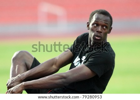 THESSALONIKI, GREECE -SEPTEMBER 11:Jamaican U. Bolt streching in the training center for the IAAF World Athletics Finals main event in Kaftatzoglio Stadium on September 11, 2009 in Thessaloniki,Greece