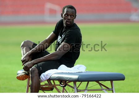 THESSALONIKI,GREECE -SEPTEMBER 11:Jamaican U. Bolt stretching in the training center for the IAAF World Athletics Finals main event in Kaftatzoglio Stadium on September 11, 2009 in Thessaloniki,Greece