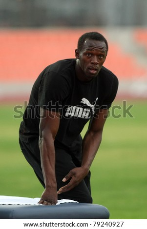 THESSALONIKI, GREECE -SEPTEMBER 11:Jamaican U.Bolt stretching in the training center for the IAAF World Athletics Finals main event in Kaftatzoglio Stadium on September 11, 2009 in Thessaloniki,Greece