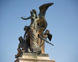They are two bronze statues depicting a winged Victory, altar of the Fatherland, Victorian, Rome, Italy.