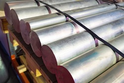 Thick aluminum rods. Aluminum warehouse. Remelting non-ferrous metals. Metallurgy. Manufacture of non-ferrous metal products. Foil production. Aluminum is in stock. Metallurgical enterprise.