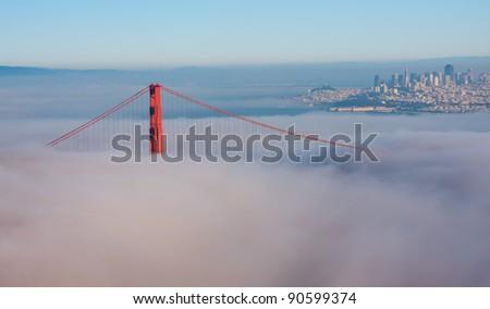 Thick fog covering Golden Gate Bridge - stock photo